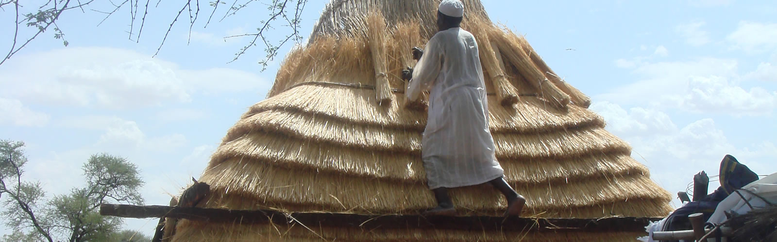 Thatching a roof in an African village